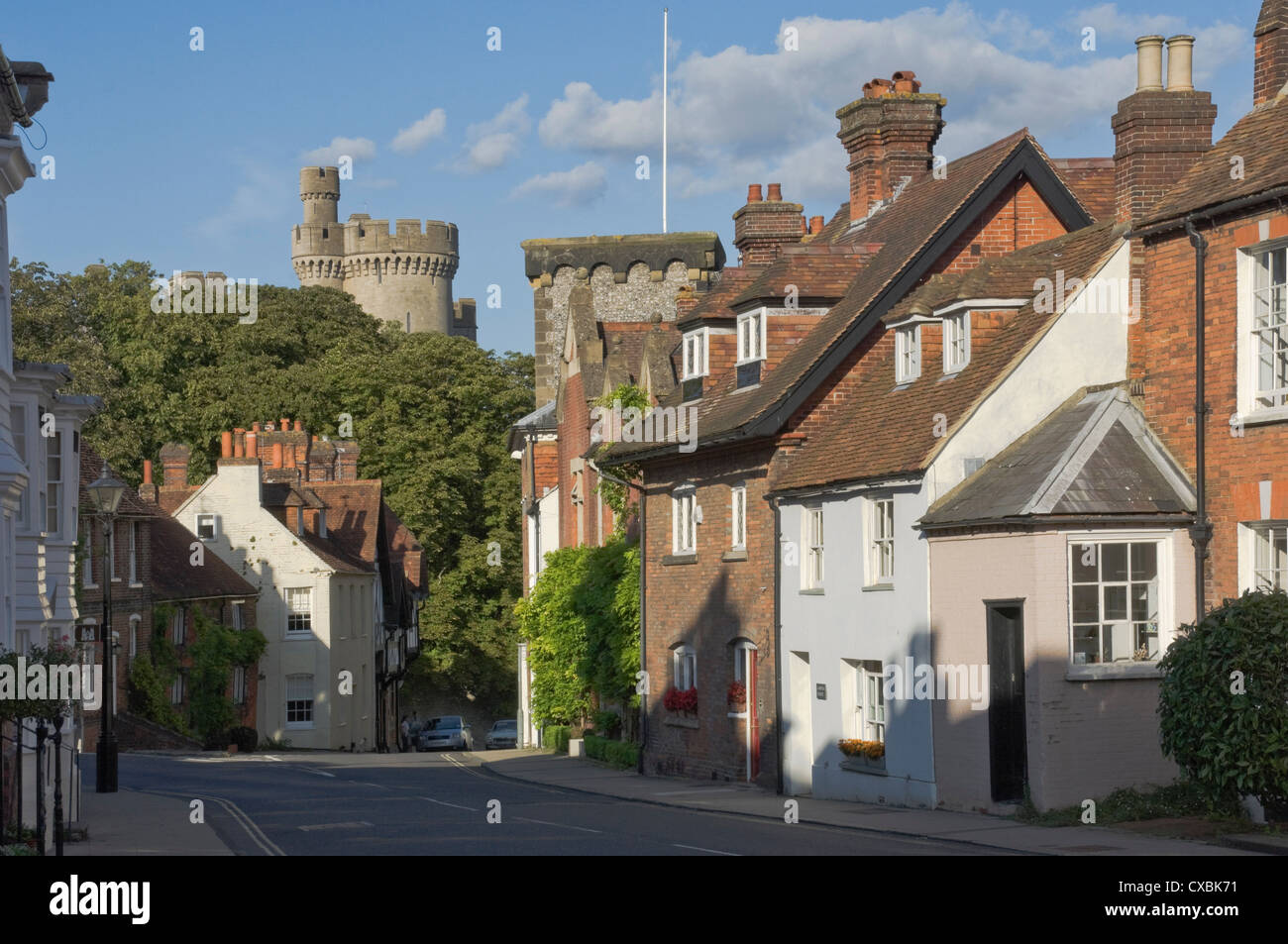 Mixed red brick dwellings approaching Arundel Castle, Arundel, West Sussex, England, United Kingdom, Europe - Stock Image
