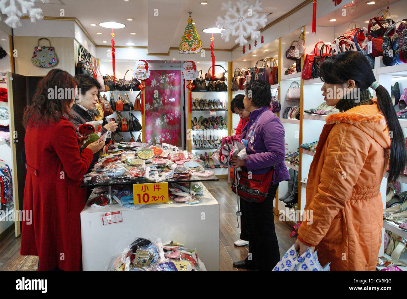 Shanghai, women when shopping in a leather goods Business - Stock Image