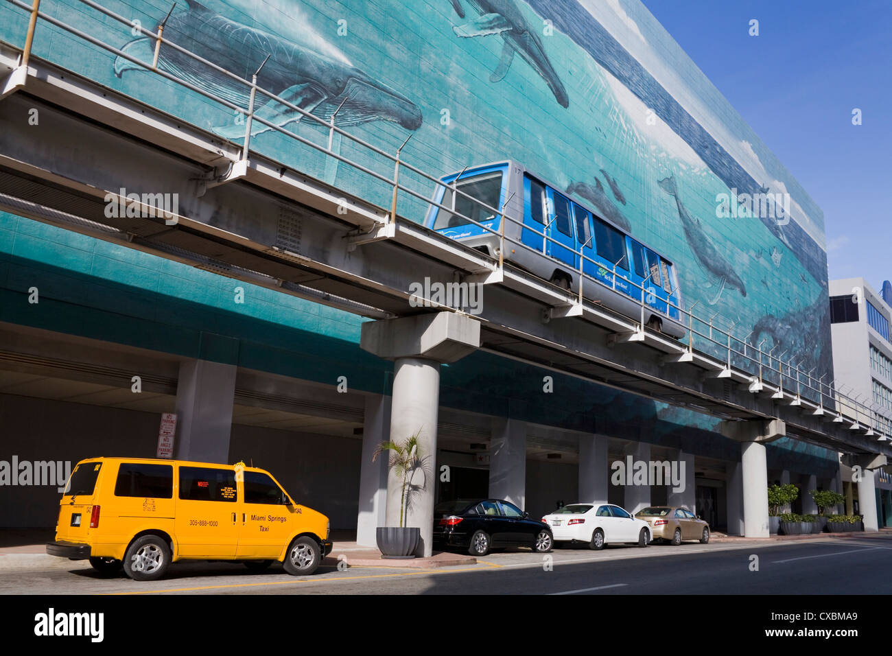 Metromover and mural by Wyland on SE 1st Street, Miami, Florida, United States of America, North America - Stock Image