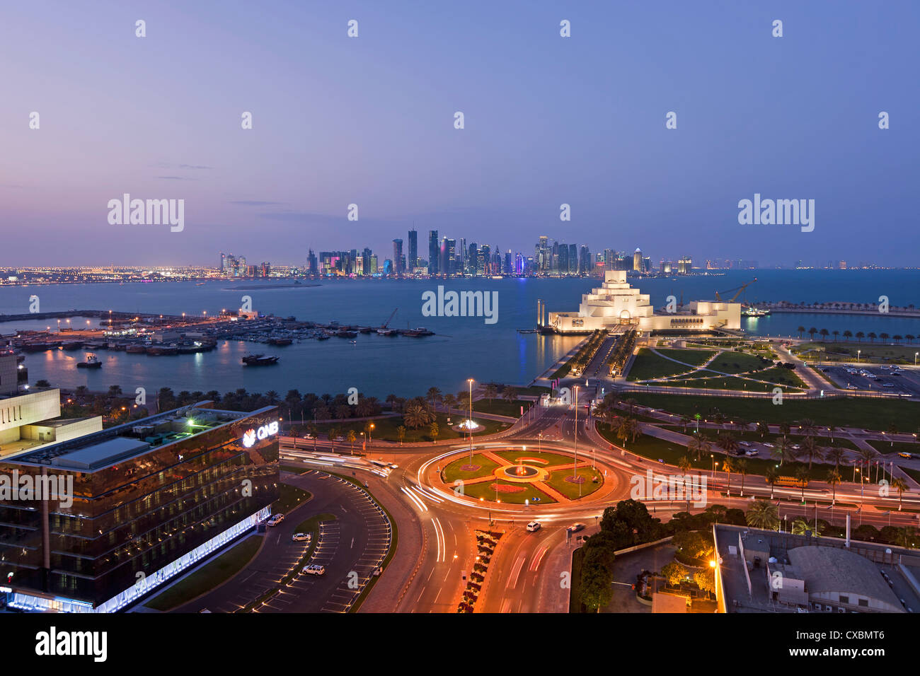 Elevated view over the Museum of Islamic Art and the Dhow harbour to the modern skyscraper skyline, Doha, Qatar, Stock Photo