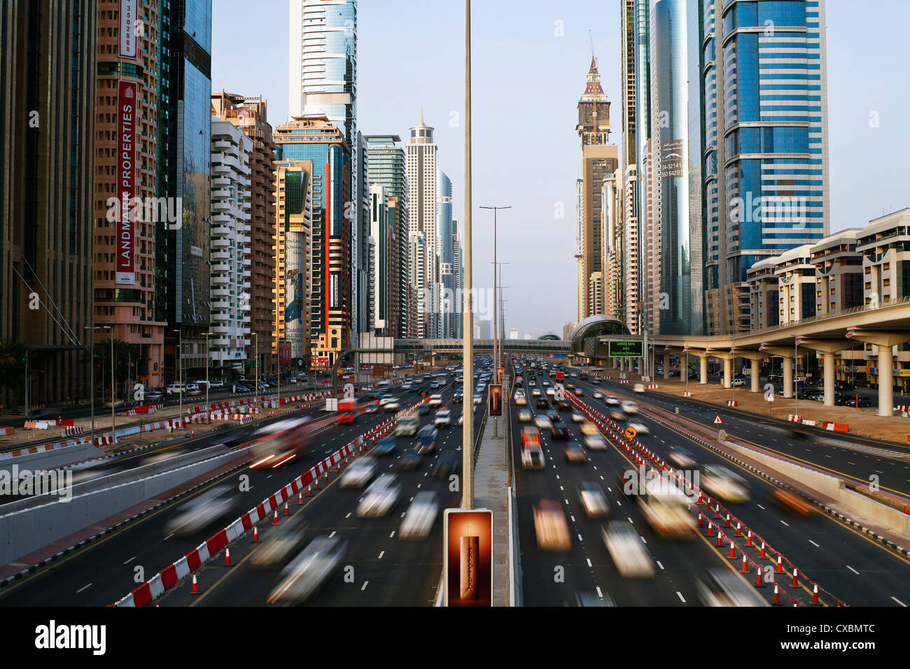 Traffic and new high rise buildings along Sheikh Zayed Road, Dubai, United Arab Emirates, Middle East - Stock Image