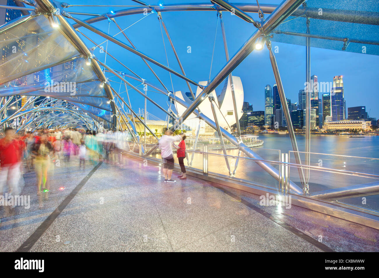 The Helix Bridge and Marina Bay Sands, Marina Bay, Singapore, Southeast Asia, Asia - Stock Image