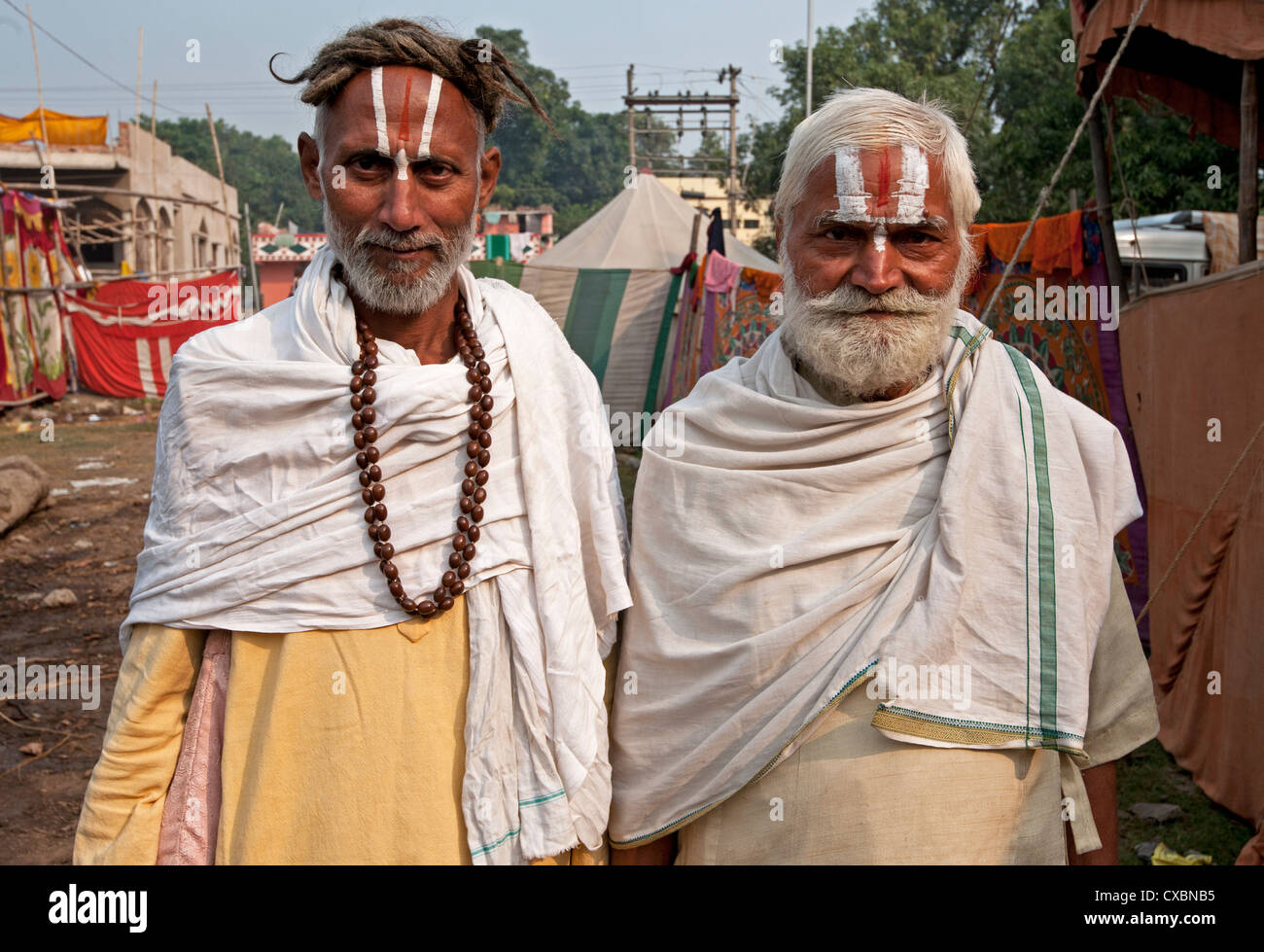 Two men with Vaishnavite sandalwood tilaks on their foreheads, one man with long uncut hair, Sonepur Cattle Fair, - Stock Image