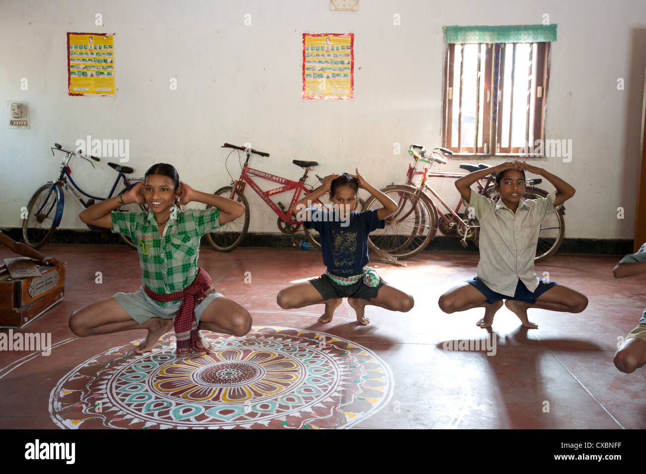 Young boys being trained as female Gotipua dancers performing in praise of Lord Jagannath and Lord Krishna, Raghurajpur, - Stock Image