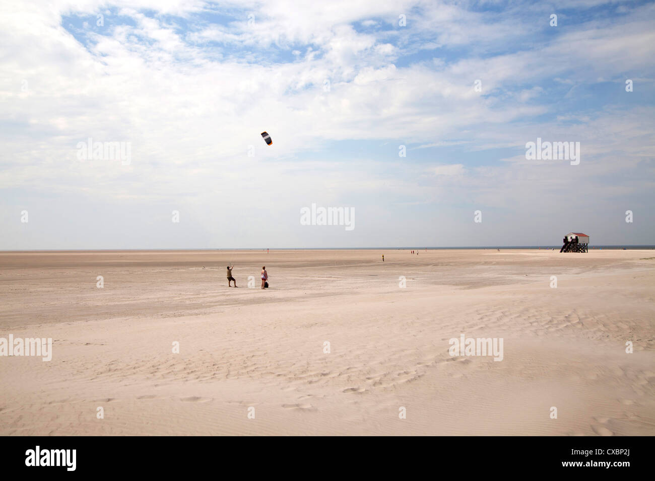The long wide sandy beach of St. Peter-Ording, district of North Friesland, Schleswig-Holstein, Germany, Europe - Stock Image