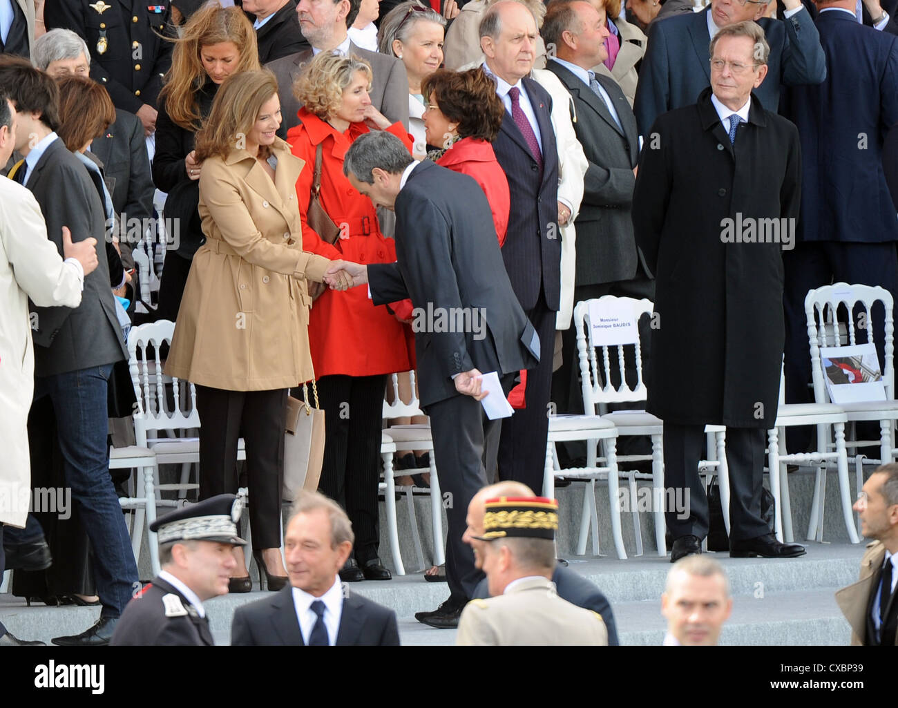 Valerie Trierweiler, the partner of French president Francois Hollande, is being greeted during the Bastille day - Stock Image