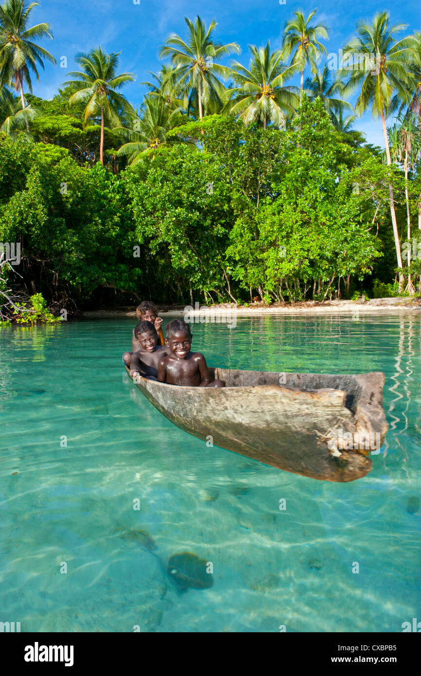 Young boys fishing in the Marovo Lagoon, Solomon Islands, Pacific - Stock Image
