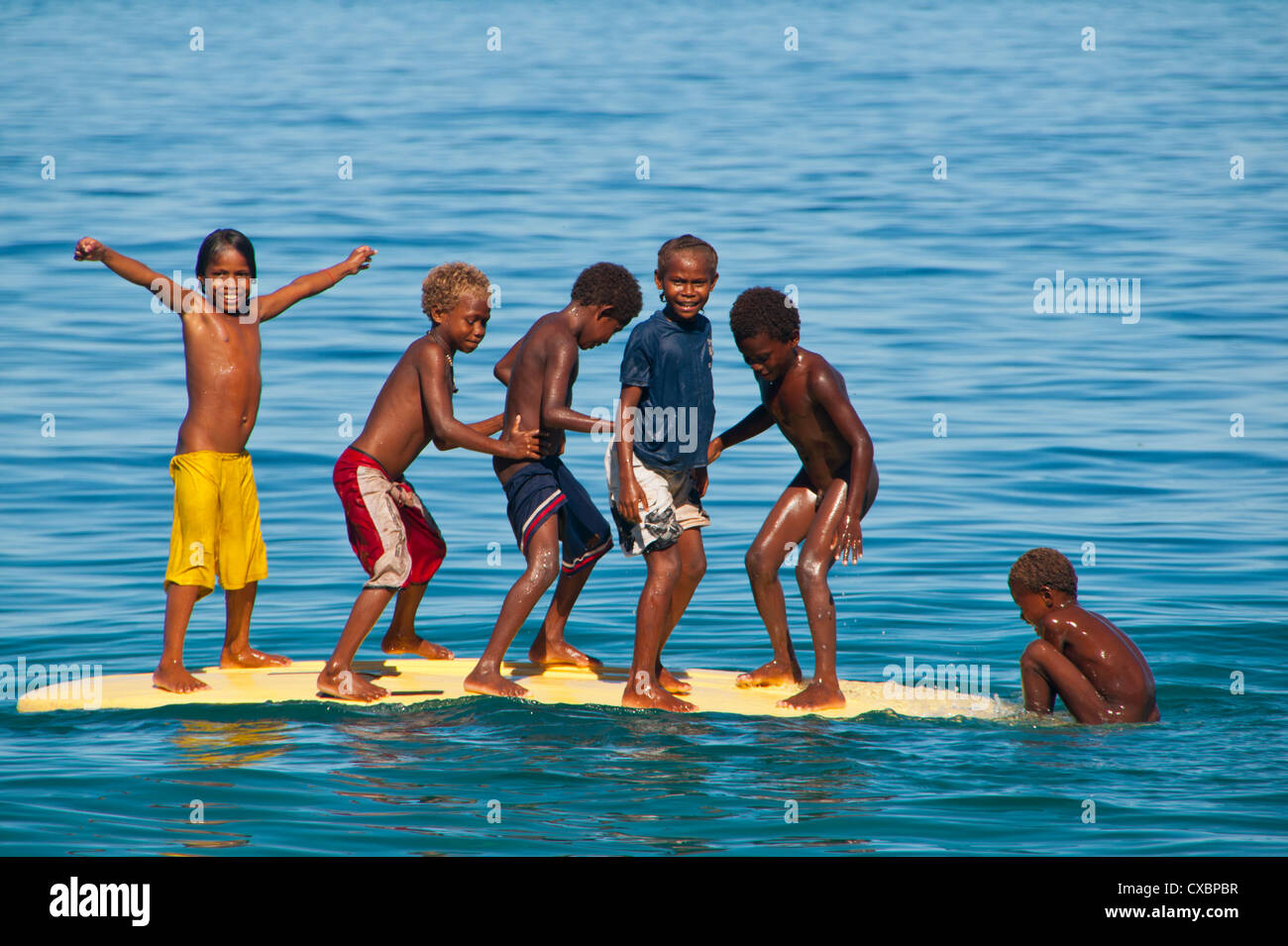 Happy children playing on the beach of Savo island, Solomon Islands, Pacific - Stock Image