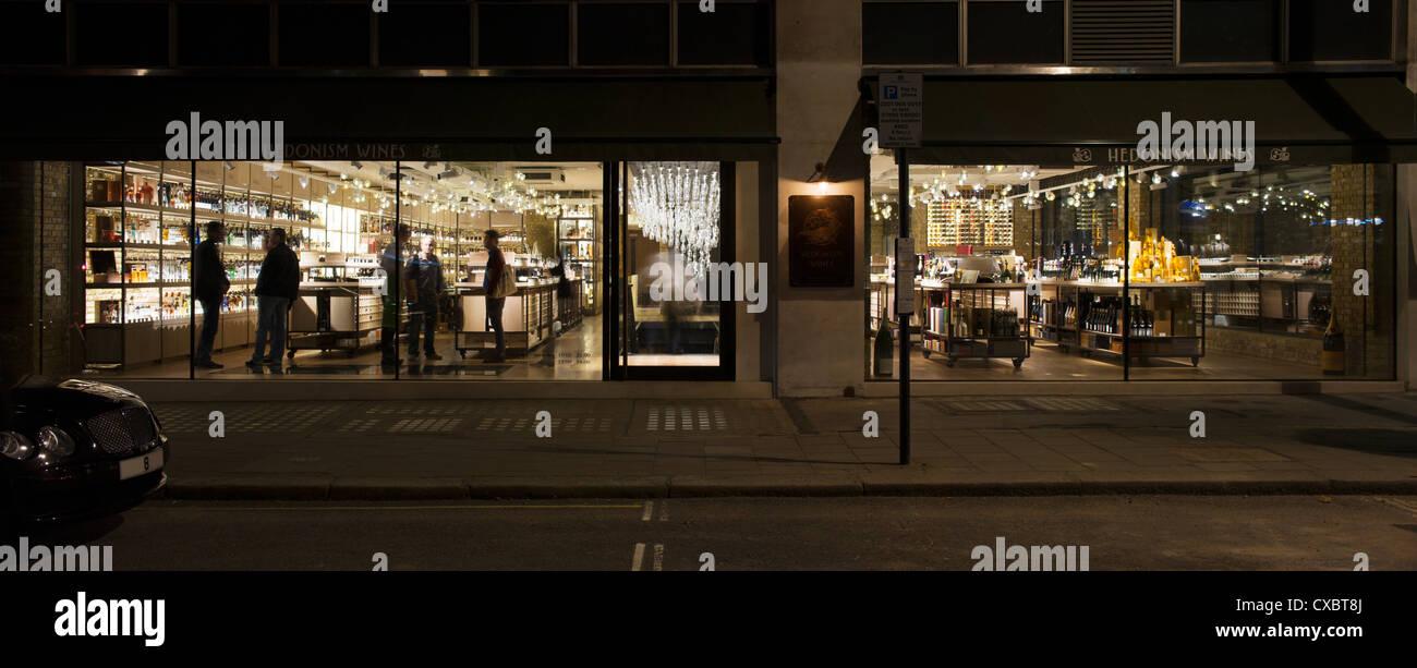 Hedonism Wines, London, United Kingdom. Architect: Universal Design Studio,  Speirs + Major, 2012. Exterior View Into Shop.