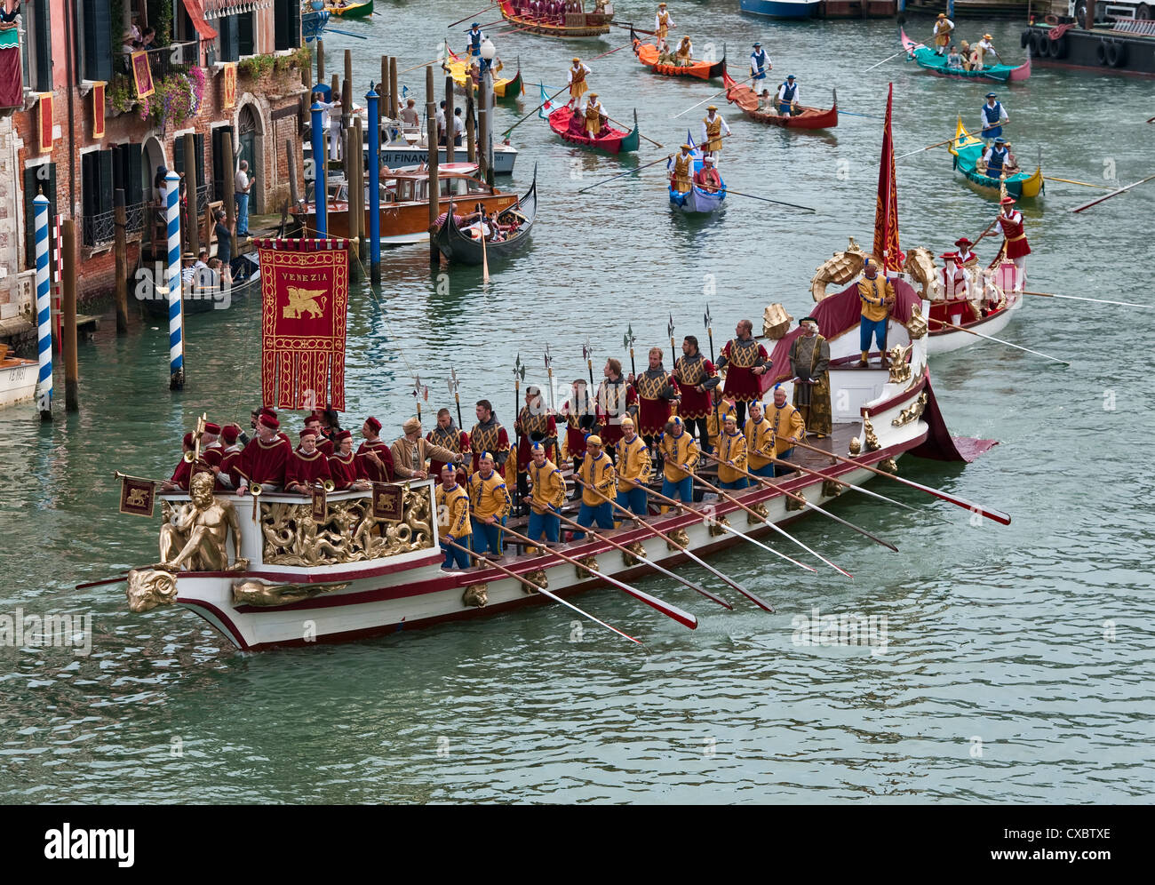 Venice, Italy. The Bucintoro leads the procession of historic boats during the annual  Regata Storico (Historic - Stock Image