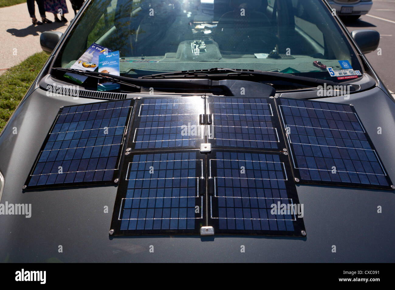 Solar cells installed on electric car hood - Stock Image