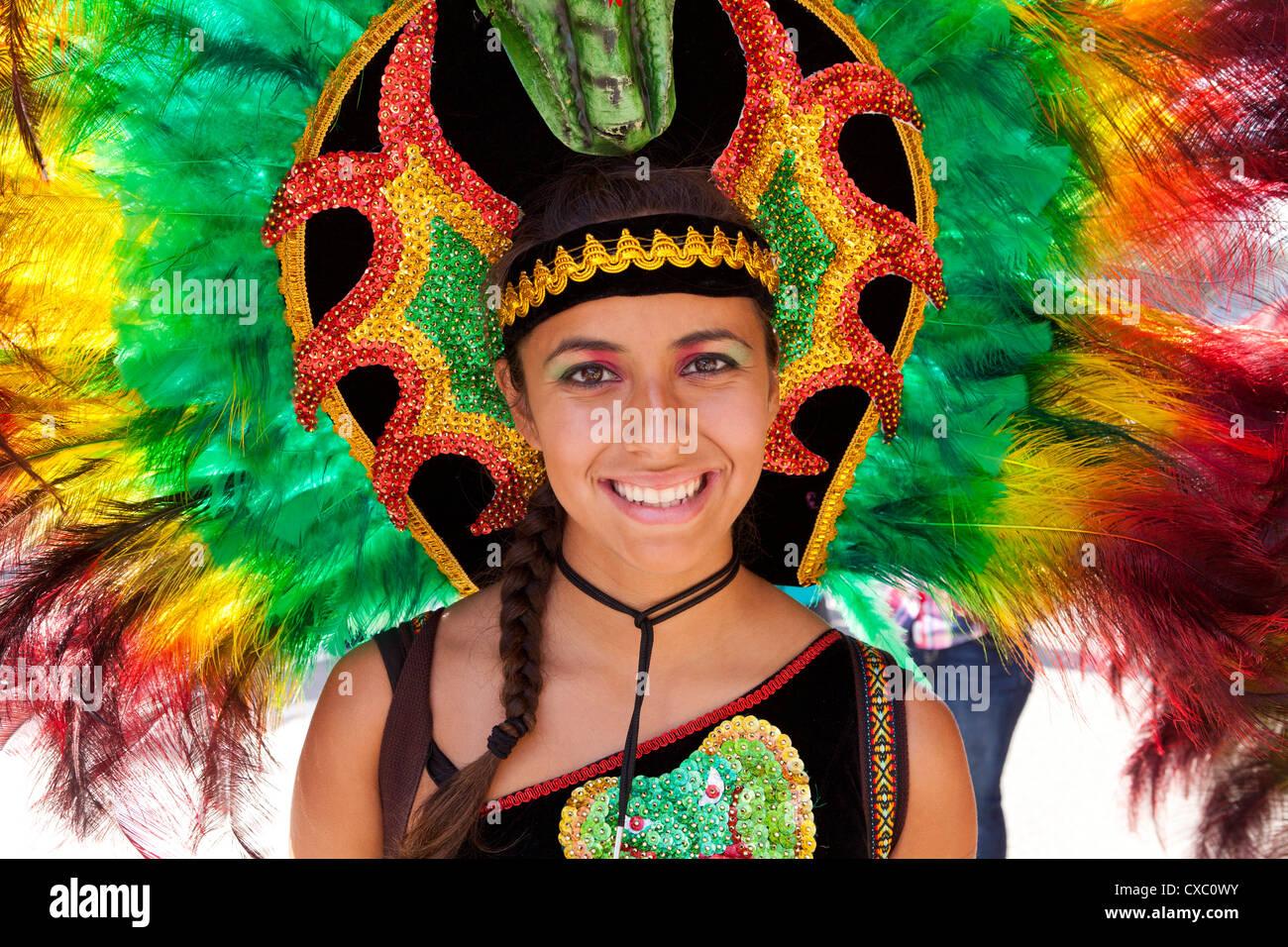 Bolivian traditional folk dancer with feather headdress at Latino festival - Washington, DC USA - Stock Image
