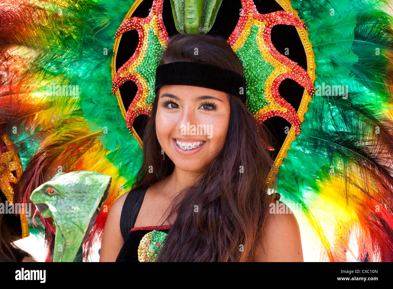 Bolivian traditional folk dancer with feather headdress at Latino festival - Washington, DC USA - Stock Image