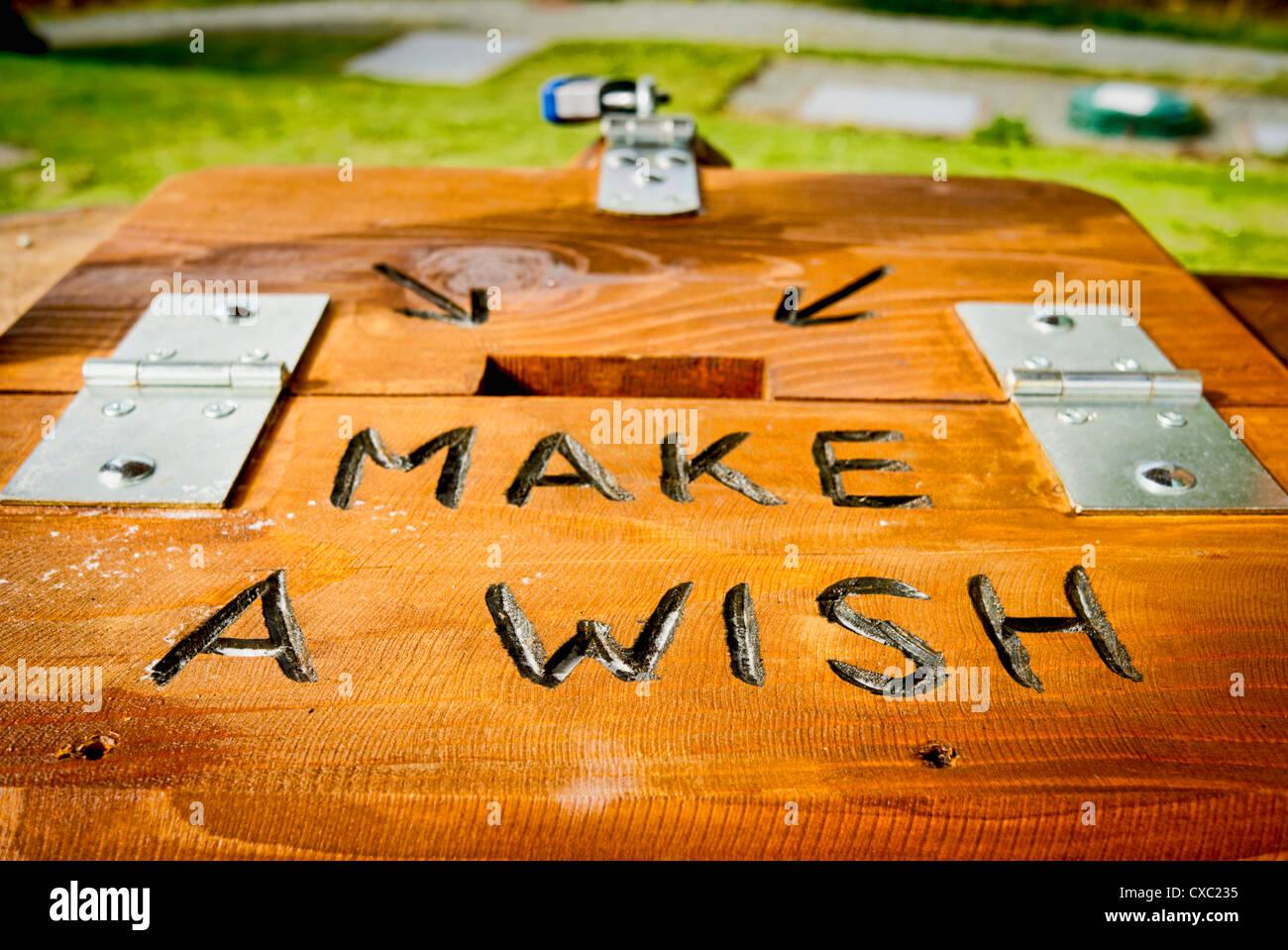 MAKE A WISH plea on fund-raising wishing well - Stock Image