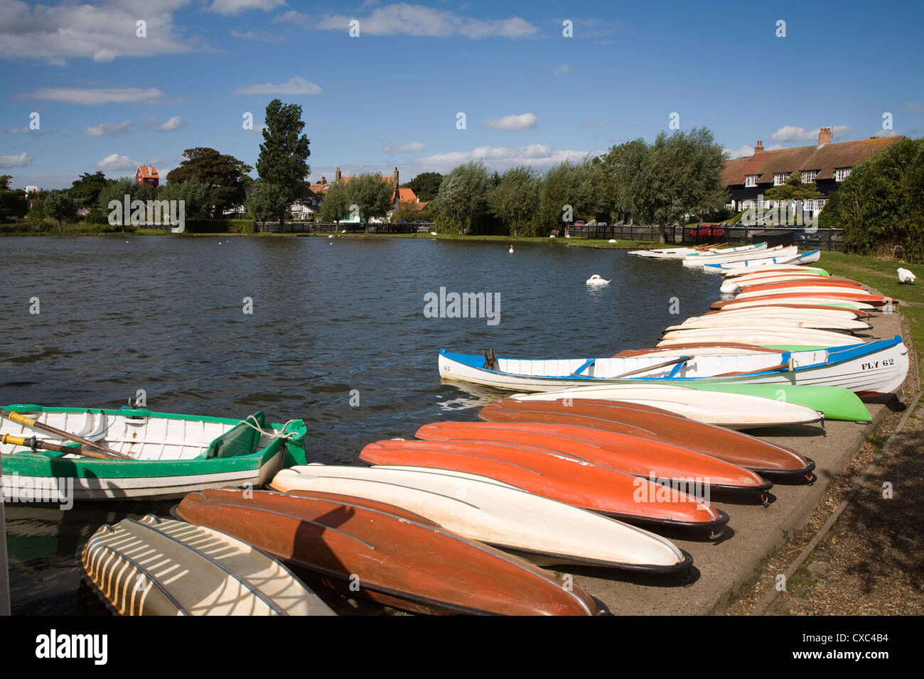 Colourful rowing boats on the Meare boating lake Thorpeness Suffolk England - Stock Image