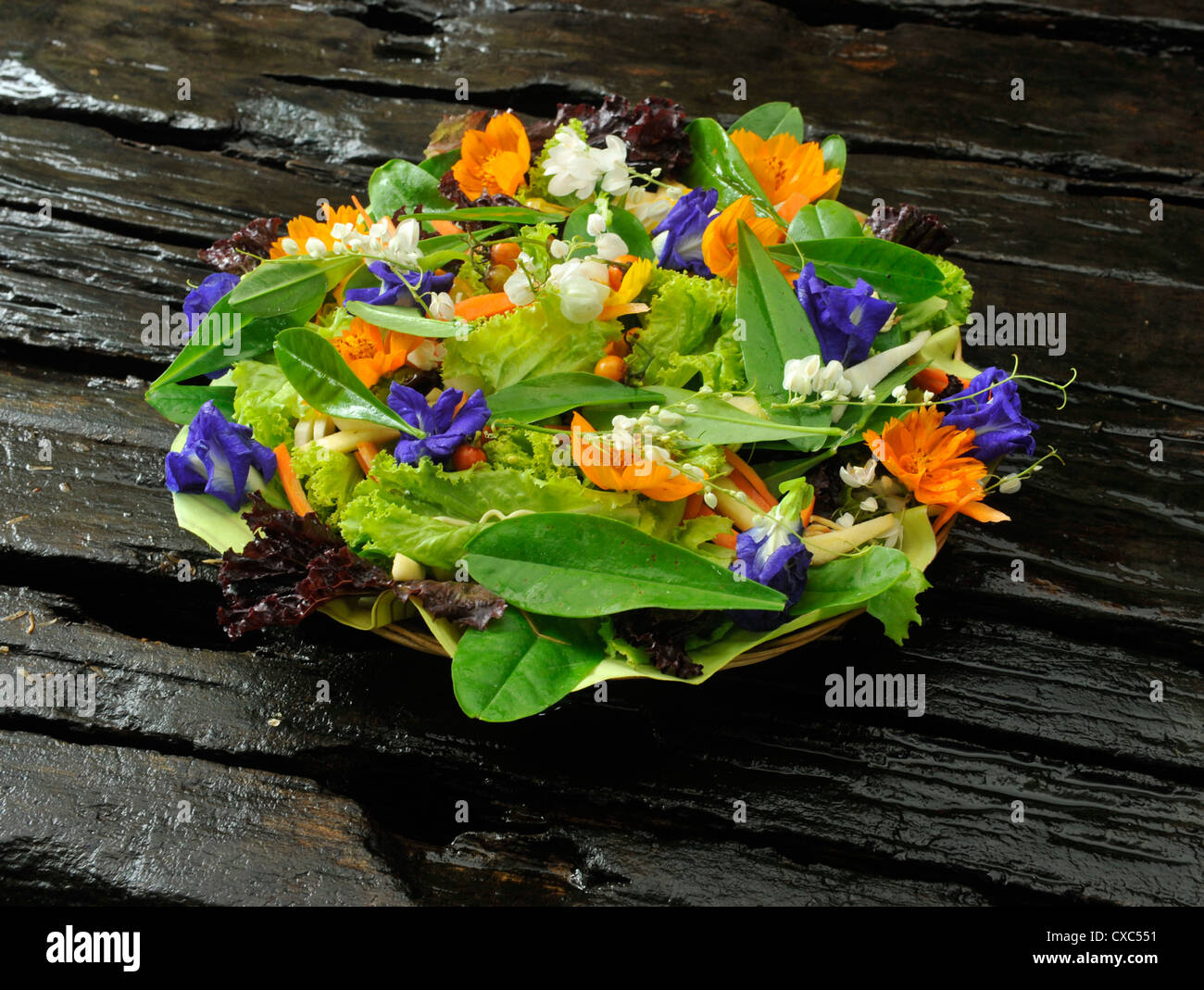 Fresh salad with edible flowers, Philippines, Southeast Asia, Asia - Stock Image