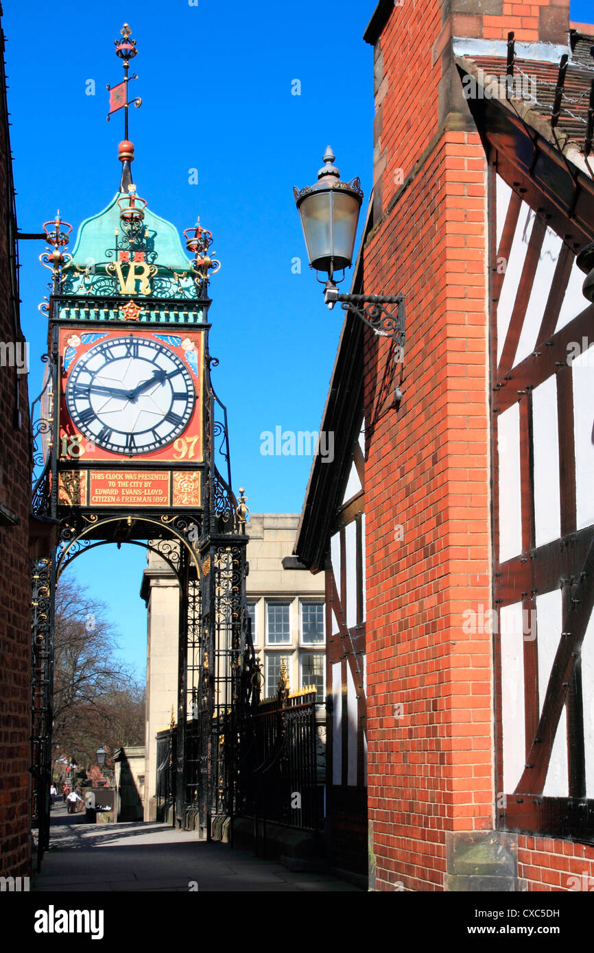 Pedestrian bridge over Eastgate, with clock, Chester, Cheshire, England, United Kingdom, Europe - Stock Image