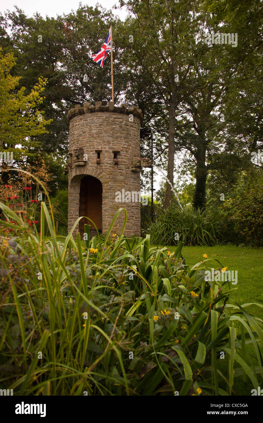 Stone tower with water feature and dove coot and water spouting ...