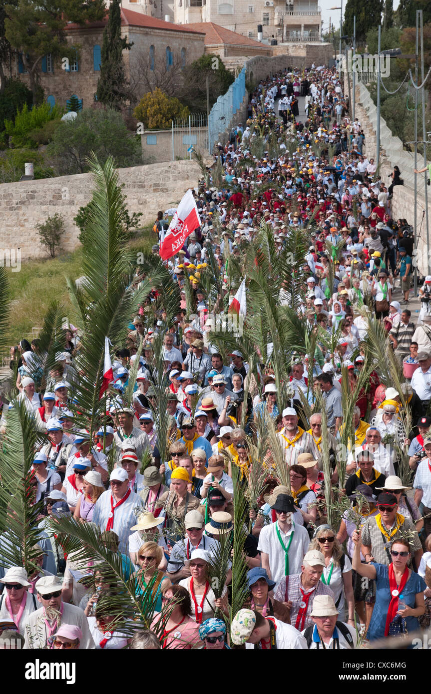 The Palm Sunday procession from Betphage to Sainte Anne in the Old City through the Mount of Olives, Jerusalem, - Stock Image