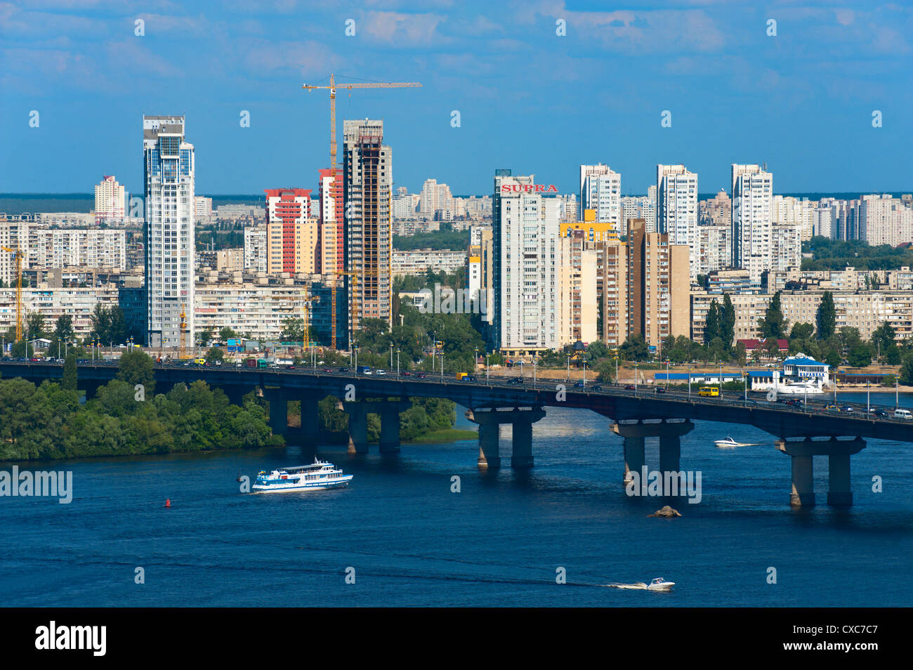 View towards Patona Bridge and Berezniaky over the Dnipro River, Kiev, Ukraine, Europe - Stock Image
