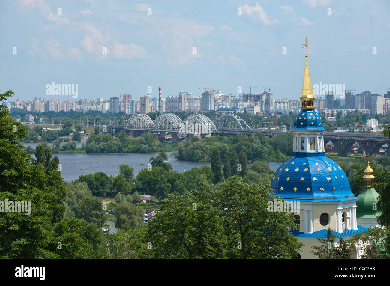 View of Vydubychi Monastery, looking over the Dnipro River to the residential area of Berezniaky, Kiev, Ukraine, - Stock Image