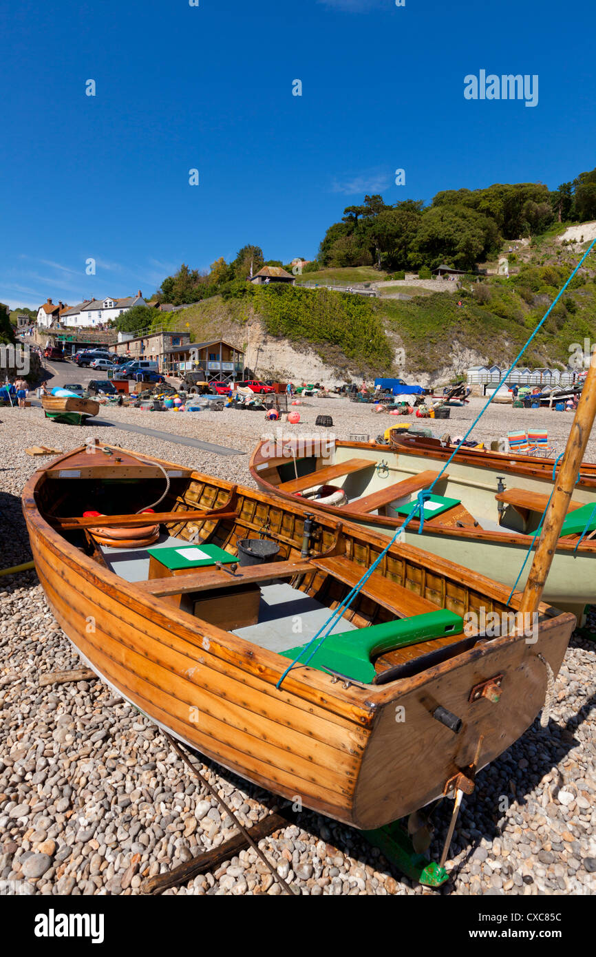 Small fishing boats on the pebble beach, Beer, a small fishing village on the Devon Heritage Coast, Jurassic Coast, - Stock Image