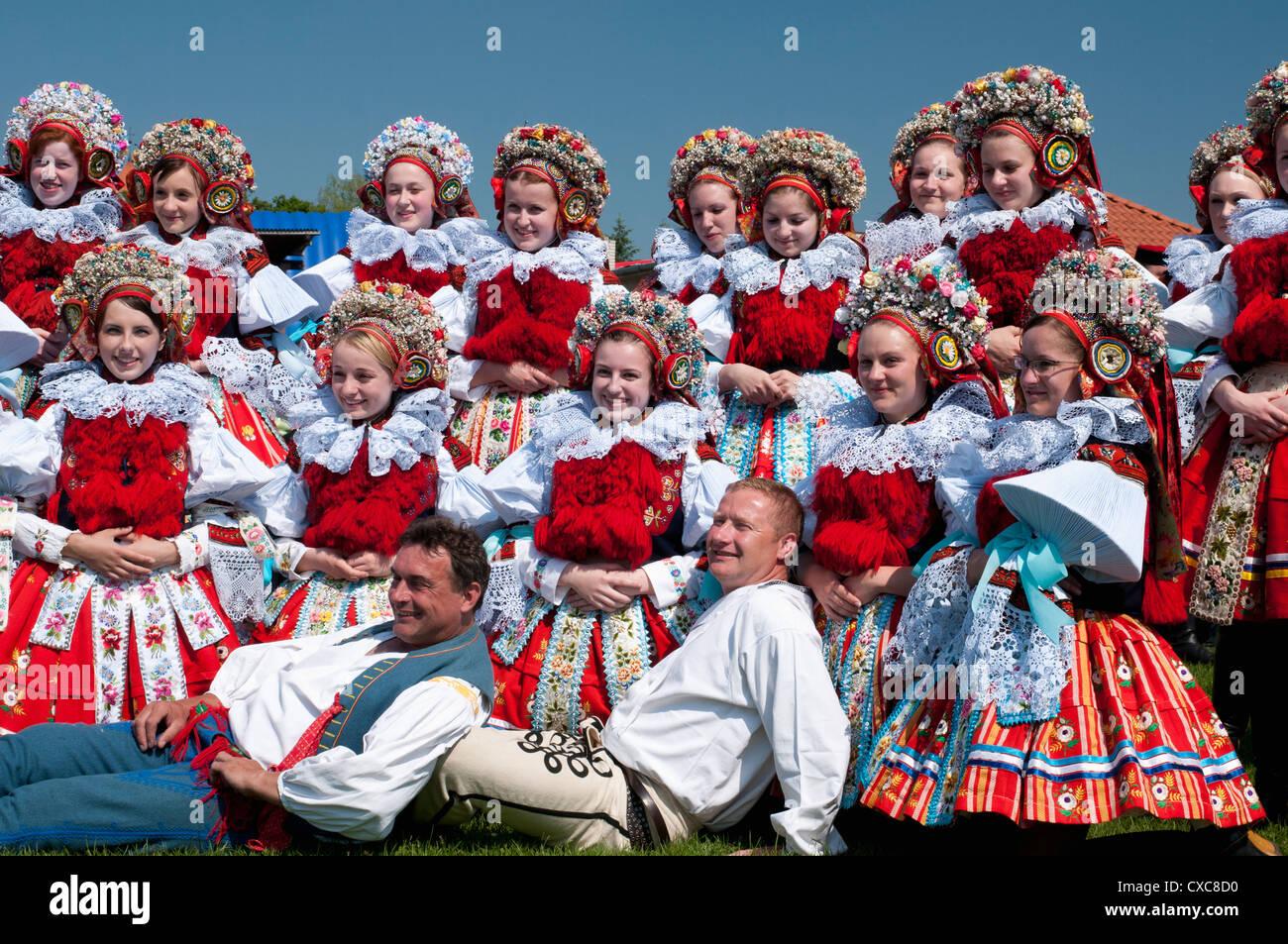 Girls and men wearing folk dress, The Ride of the Kings festival, Vlcnov, Zlinsko, Czech Republic, Europe - Stock Image