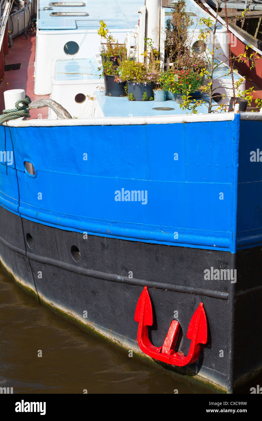 House boat at the Amstel river - Amsterdam, Netherlands, Europe - Stock Image
