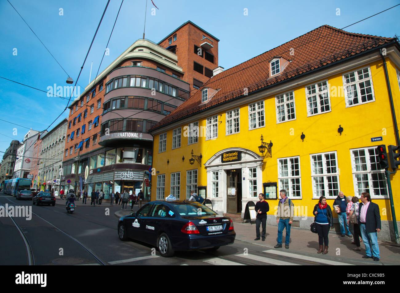 Taxi in Grensen street Sentrum central Oslo Norway Europe - Stock Image