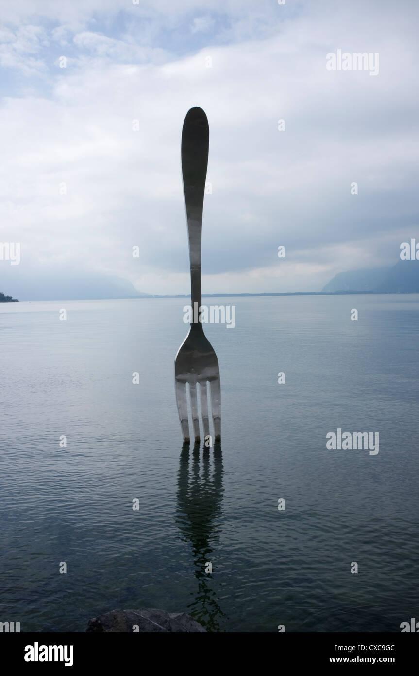 Large Fork Sculpture in Lake Geneva -2 - Stock Image