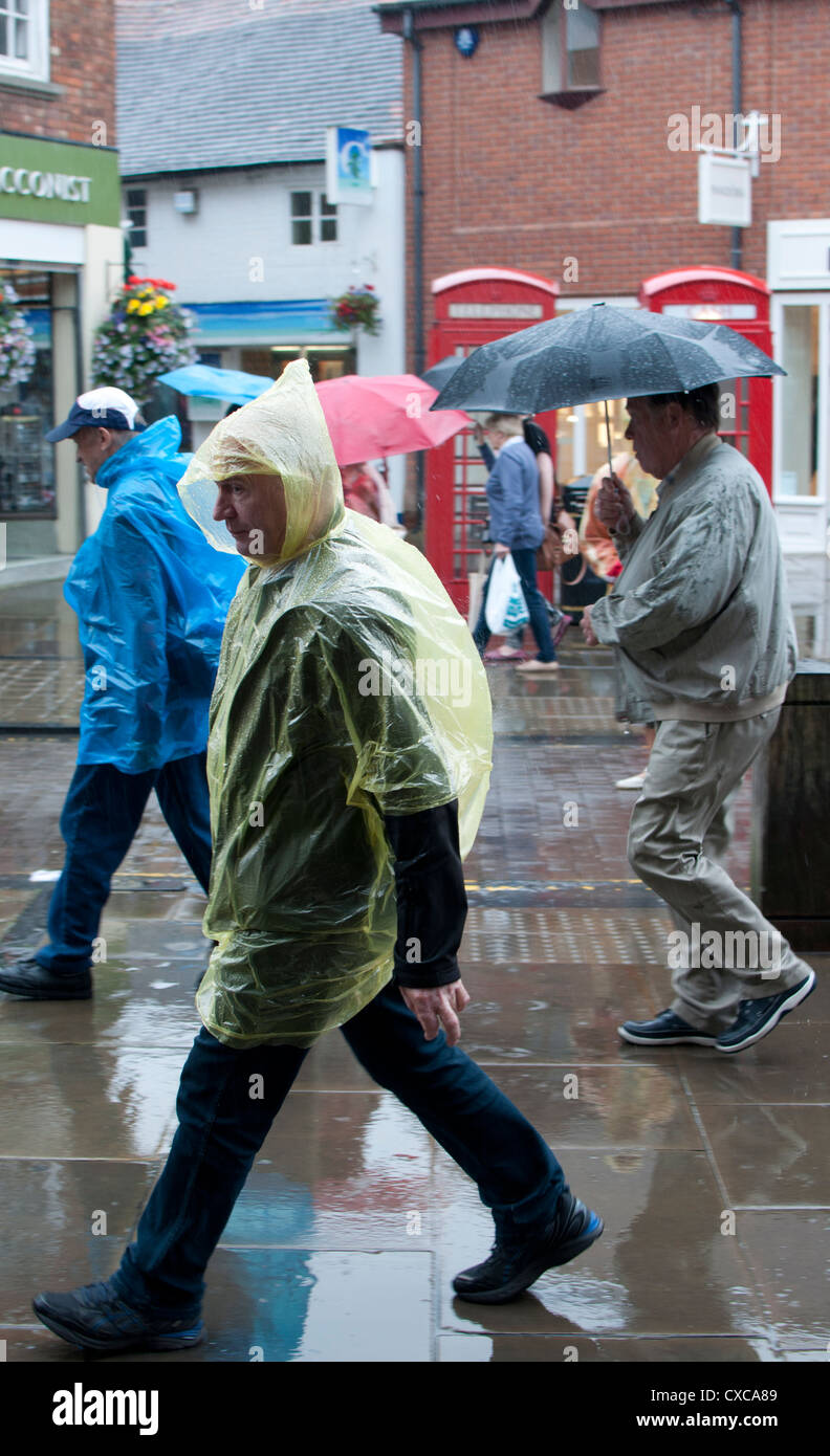 Tourists in wet weather, UK - Stock Image