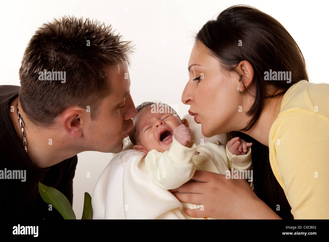 Mom And Dad Kissing Newborn Baby Son Stock Photo Alamy