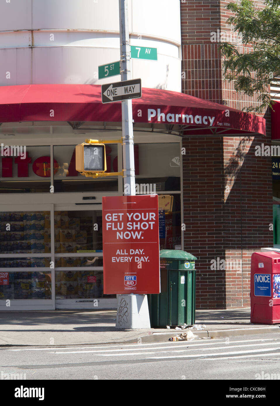 Flu shots advertised on the street outside a major pharmacy in Park Slope Brooklyn. Possible conflict of interest - Stock Image