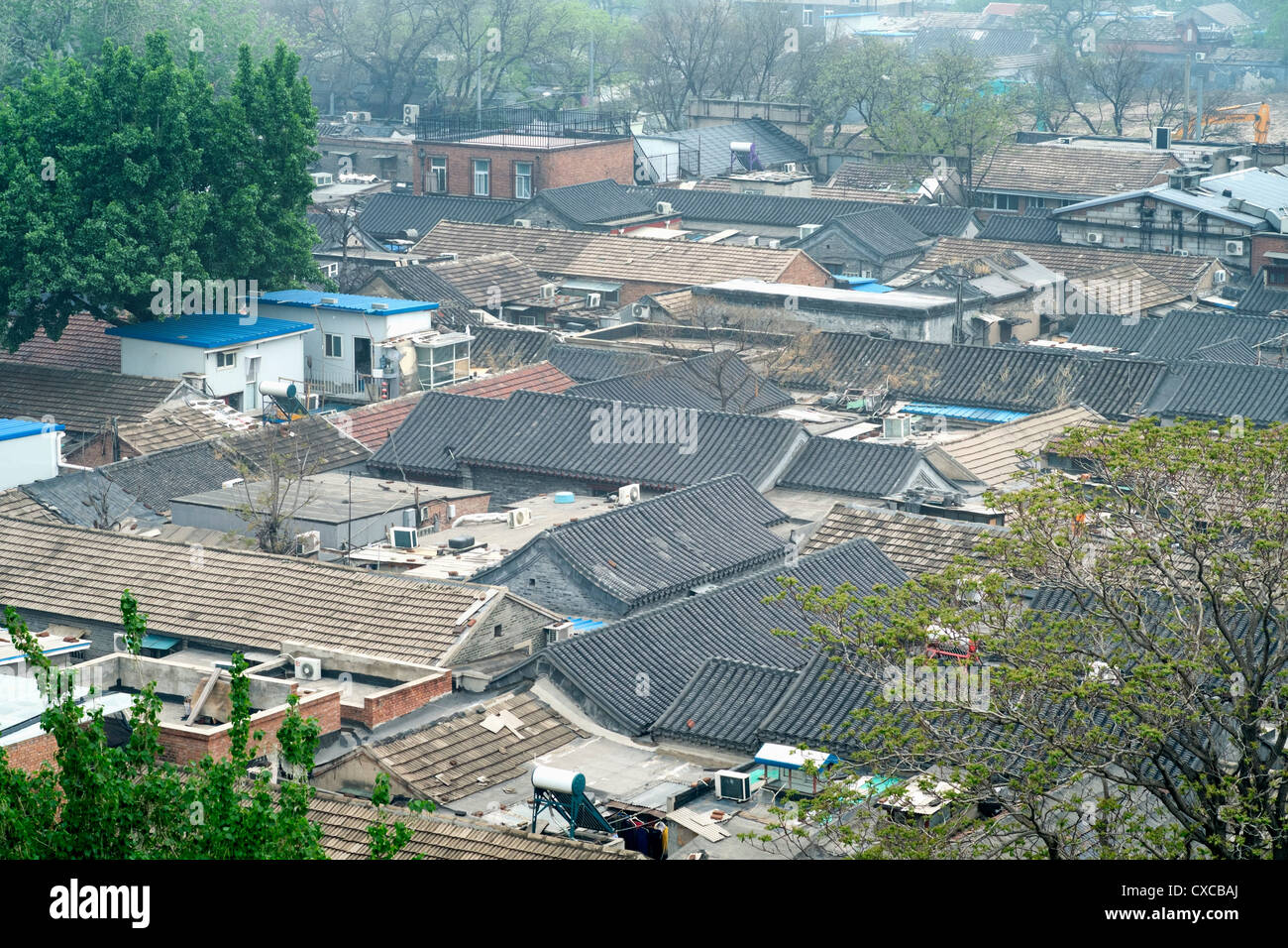 View of rooftops of old houses in area with many hutongs or lanes in central Beijing China - Stock Image