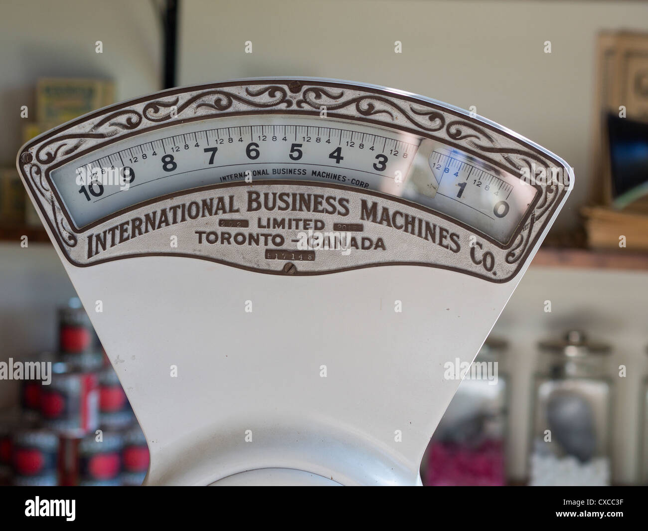 Weigh Scale: an early IBM. An early IBM from Toronto Canada. This one doesn't do much calculation, just weighs - Stock Image