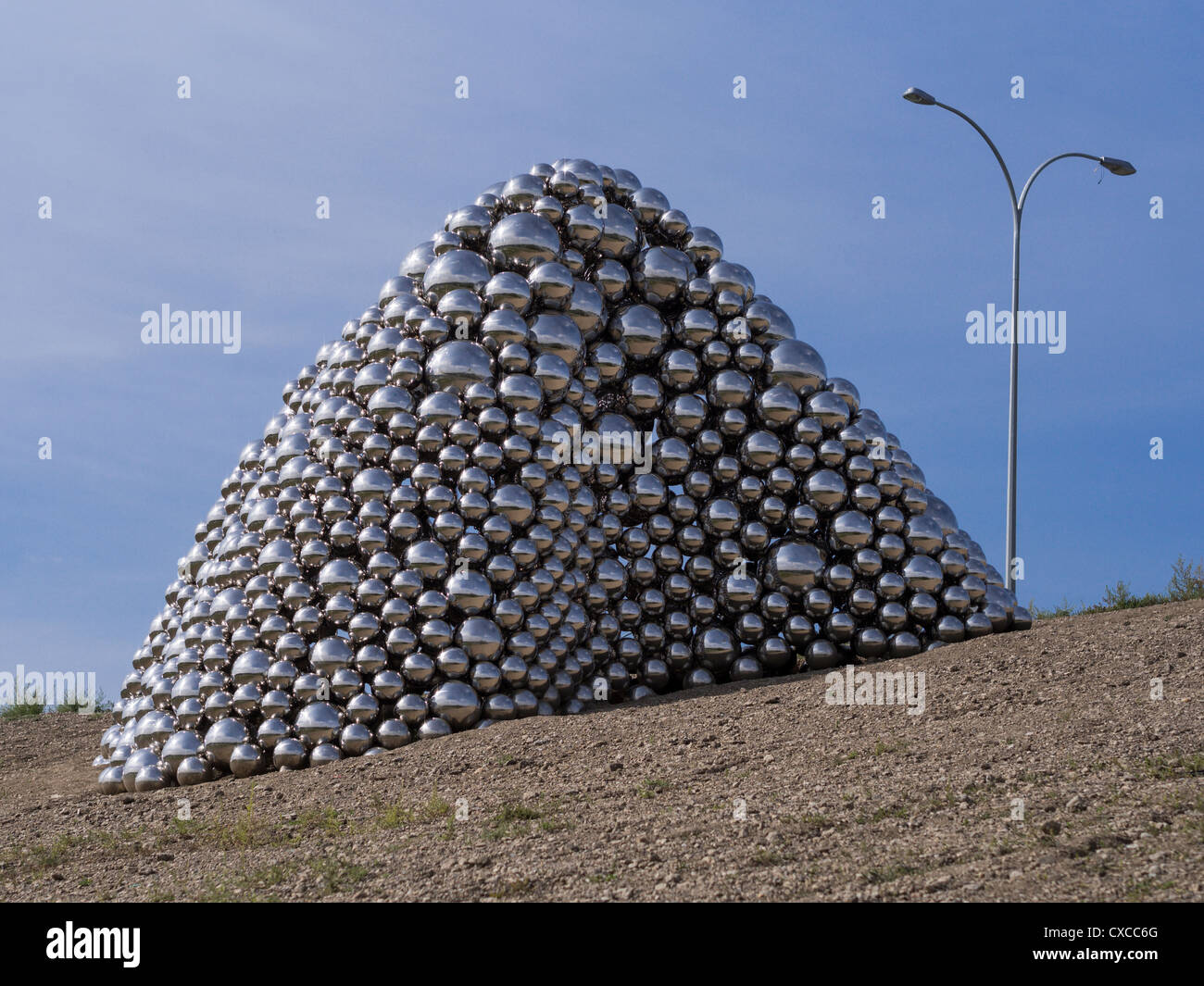 Talus Dome Sculpture with lamp. A $750,000 public art project along the side of a highway in Edmonton. - Stock Image