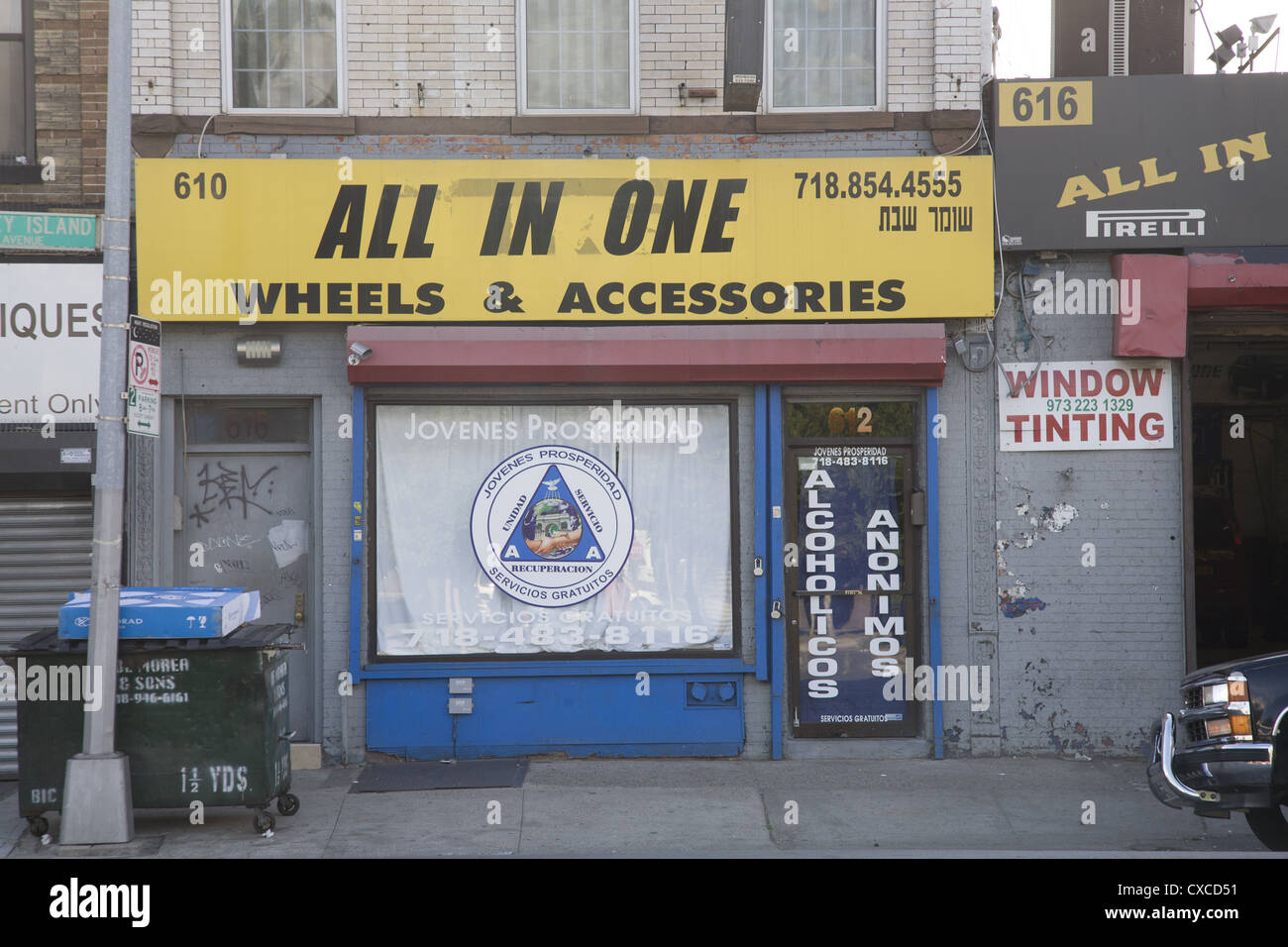 Storefront for Alcoholics Anonymous & other therapies along automotive alley on Coney Island Ave in Brooklyn, - Stock Image