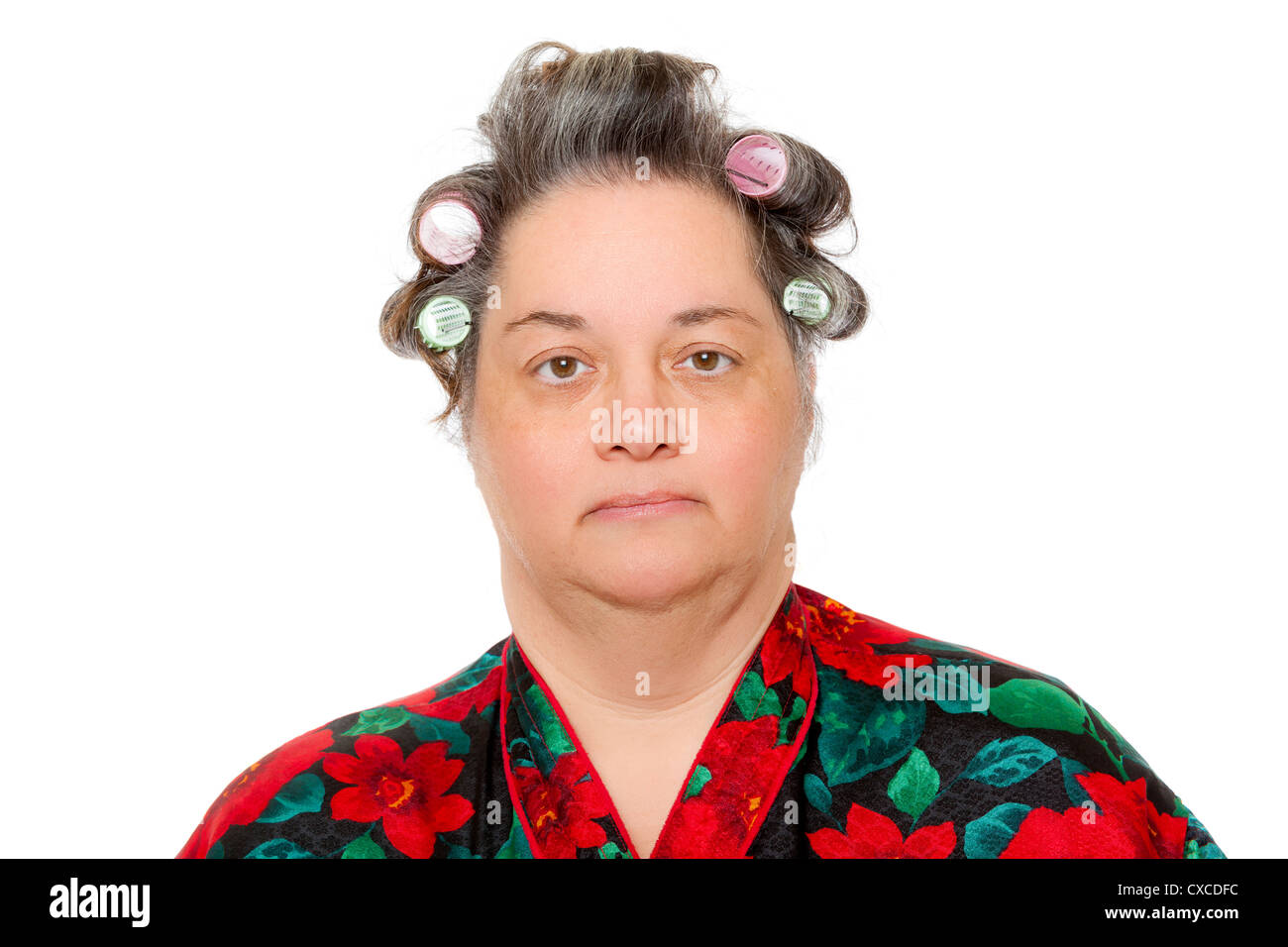 a middle aged woman wearing curlers in her hair stock photo
