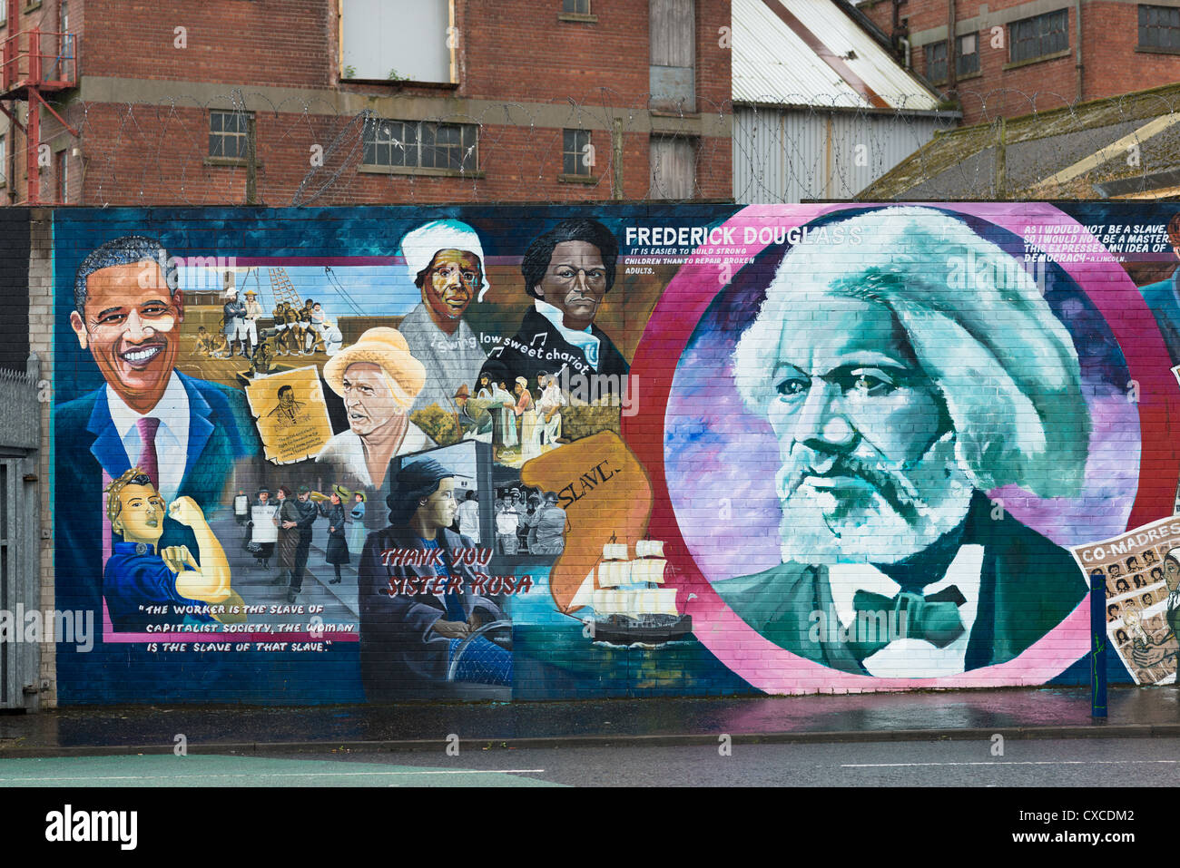Political murals on Catholic Falls road, Belfast in Northern Ireland. - Stock Image