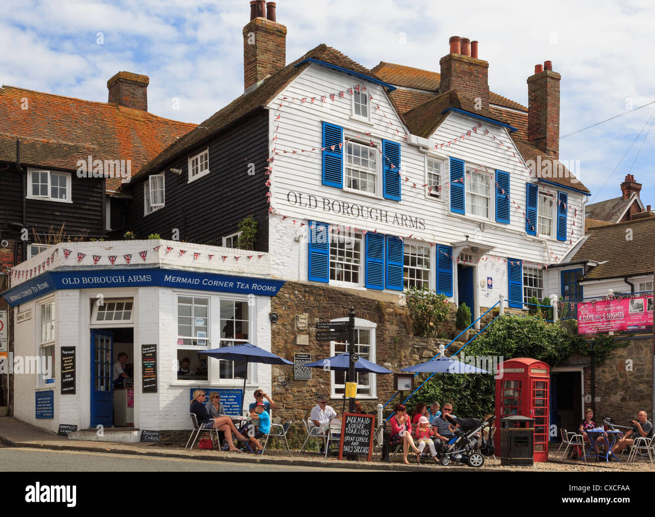 Old Borough Arms hotel and Mermaid Corner tea rooms with people sitting outside in Rye, East Sussex, England, UK, Stock Photo
