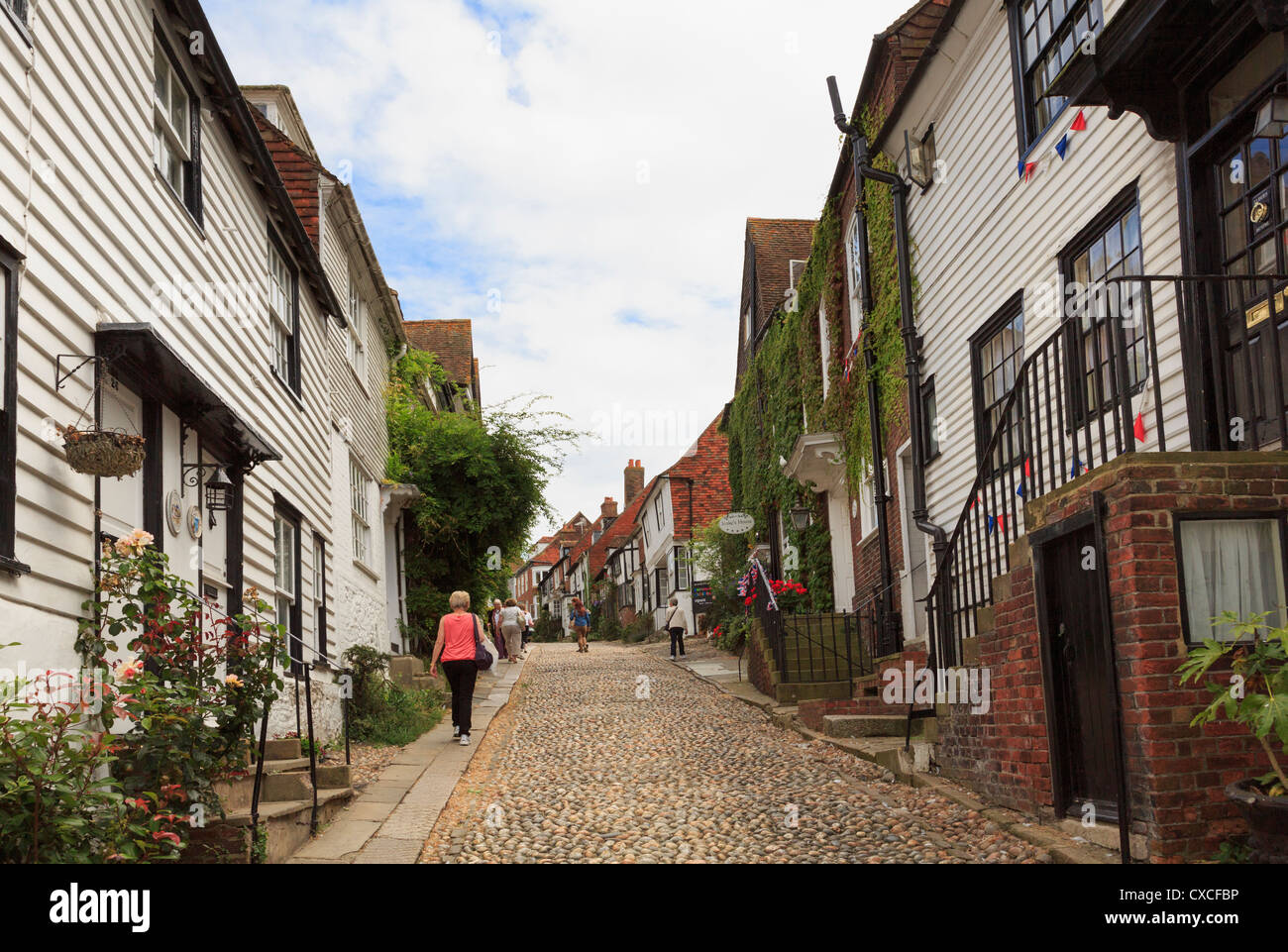 View up the famous narrow cobbled street lined with quaint old houses in Mermaid Street, Rye, East Sussex, England, - Stock Image