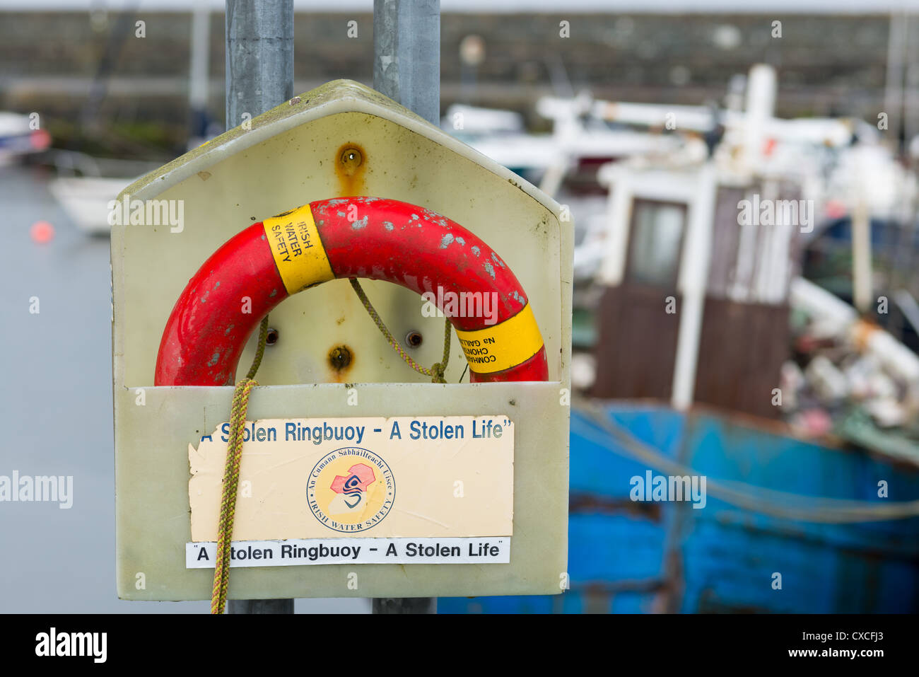Irish Water safety lifebelt on Galway coast, Republic of Ireland. - Stock Image