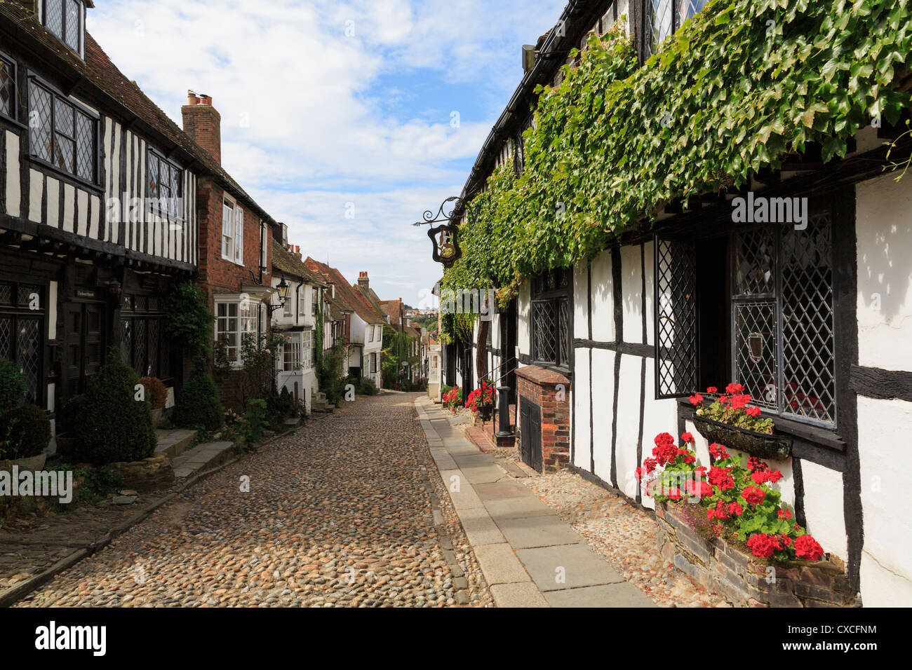 15th century timbered Mermaid Inn on quaint narrow cobbled street in historic picturesque Cinque Port town of Rye - Stock Image