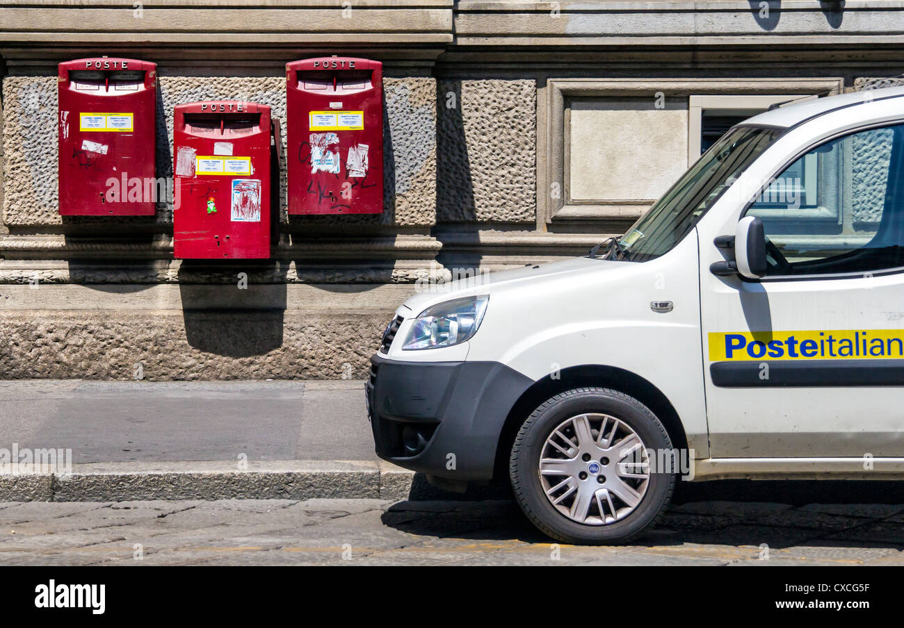 Italian Postal Service - Post Boxes and delivery vehicle - Milan Italy - Stock Image