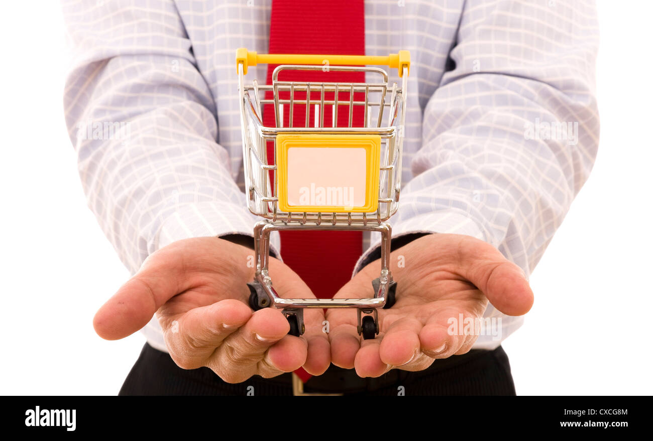 Shopping Concept - Hand holding a trolley shop (put your text on the Trolley) - Stock Image