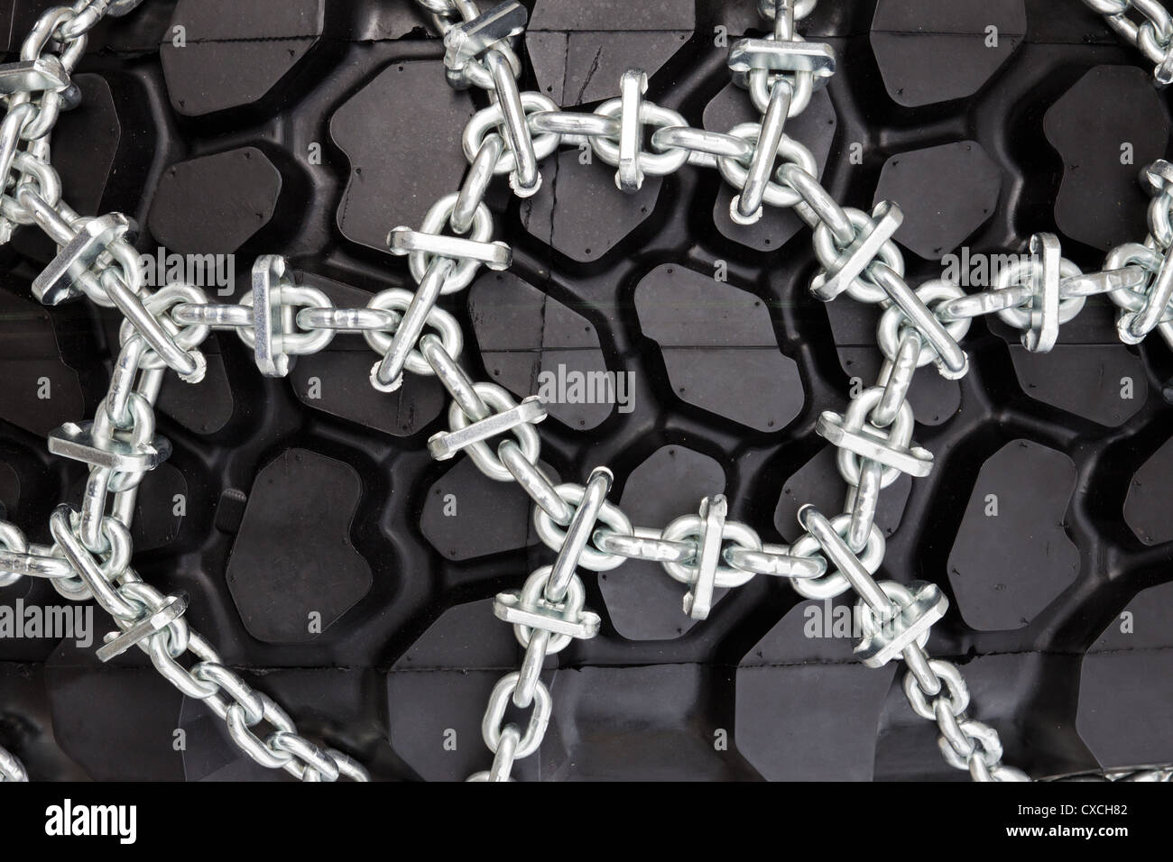 Large truck tire with snow chains - Stock Image