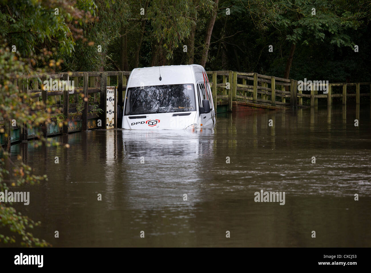 A parcel delivery van is trapped in a ford after heavy rain in Henwood Lane, Solihull, West Midlands. - Stock Image