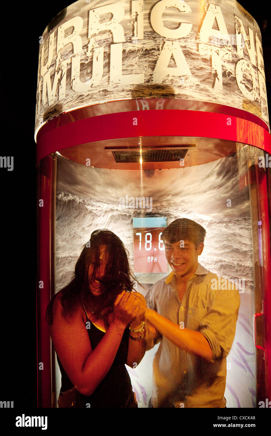 A young couple experiencing high winds in the Hurricane Simulator machine, London Aquarium, London UK - Stock Image