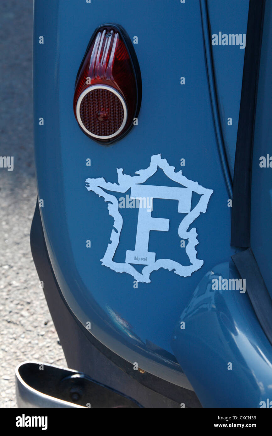 F international motoring symbol for France on the rear wing of a Citroen Traction Avant emblematic French car of - Stock Image