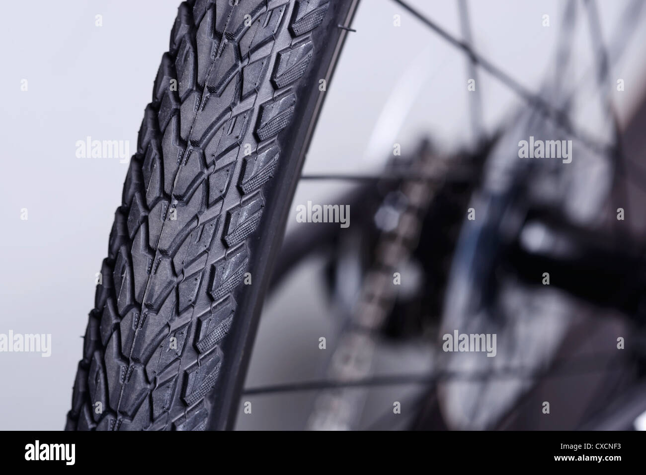 Detail of the rear tyre and wheel of a bicycle - Stock Image